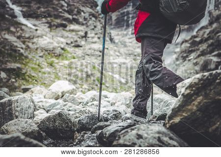 Mountain Trail Hiker. Active Outdoor Recreation Concept Photo. Hikers Legs And The Rocky Trailhead.