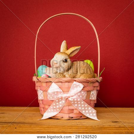 A sweet easter bunny figure in a basket