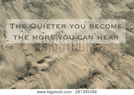 Inspirational, motivational quote against nature background. The quieter you become the more you can hear.