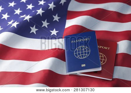 Passports on the flag of the US United Ststes. Getting a visa to USA ,  travel, naturalization and immigration concept. 3d illustration