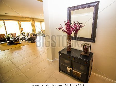 Entry Hall Mirror, Wooden Cabinet And Flower Vase