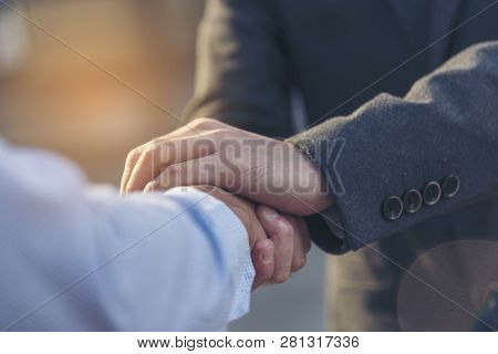 Concept Partnership. Partners Who Is Businessman And Customer Are Touching Hands Promise To Be Hones