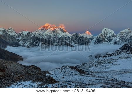 Sunset Over Everest Summit, View From Renjo La Pass. Breathtaking View Of Mountain Valley Covered Wi