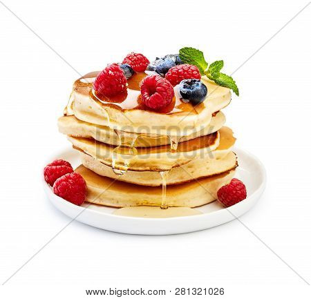 Delicious Pancakes With Berries, Honey Or Maple Syrup. Homemade Pancakes And Sweet Syrup On White Pl