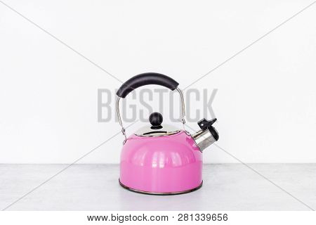 Closeup Pink Metal Kettle On Wooden Table