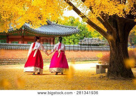Lady In Hanbok Dress Walk In Seoul Palace In Ginkgo Autumn Garden, Seoul City, South Korea