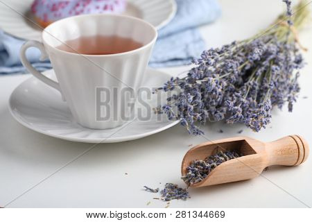 Lavender tea and lavender donut with bunch of lavender flowers