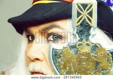 Senior Man Bearded Beefeater Yeomen Warder Or Male Royal Guard Bodyguard In Hat With Spear On Grey W