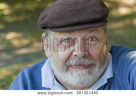 Portrait Of Funny, Suspicious Bearded Senior Man Doing First Selfie In His Life