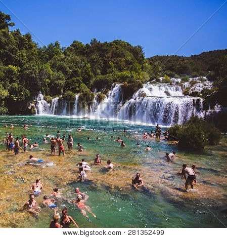 Krka National Park, Croatia - Aug 13, 2015: Plenty Of Tourists Enjoy Swimin In Krka Waterfalls In Th