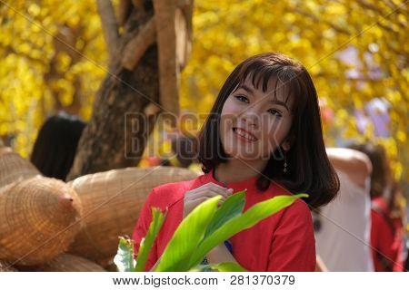 Ho Chi Minh, Vietnam 01-2019: Vietnamese Lunar New Year. Women Wear Vietnam Tradition Ao Dai To Take