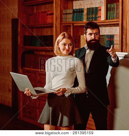 Online Concept. Bearded Man And Sensual Woman Use Digital Library Online In Laptop. University Onlin