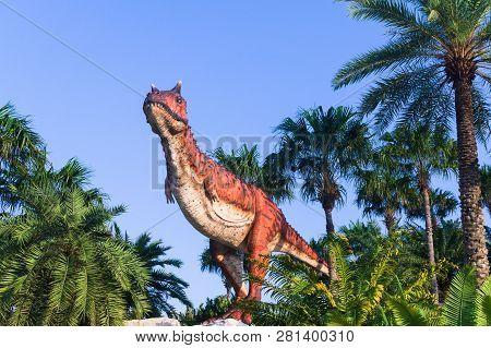 Pattaya,thailand- April 14,2018: Carnotaurus Model In A Tropical Garden Park Of Suan Nongnooch, Patt