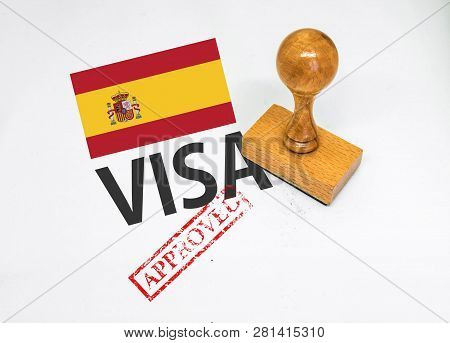 Spain Visa Approved With Rubber Stamp And Flag