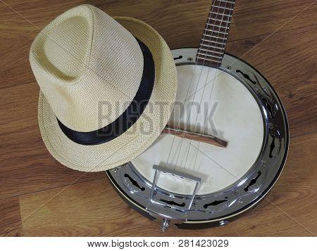 A Samba Banjo (a Brazilian String Musical Instrument) And A Samba Player (sambista) Hat On A Wooden