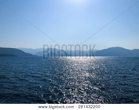 Silhouettes Of Hills And Mountains On The Mediterranean. Summer Landscape With Sea And Mountain Rang