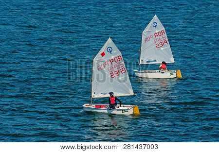 Lisbon, Portugal - April 03, 2010: Yachts In Blue Sea. Children Athletes Participate In Race On Sunn
