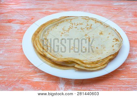 Fried Tasty Thin Slapjack On Wooden Background