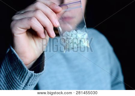 Hand Holds Packet With White Narcotic - Cocaine, Meth Or Another Drug