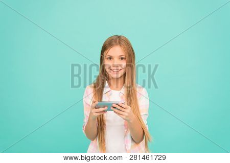 Social Experience Online. Little Girl Using Mobile Phone. Small Girl Child With Smartphone. Adorable
