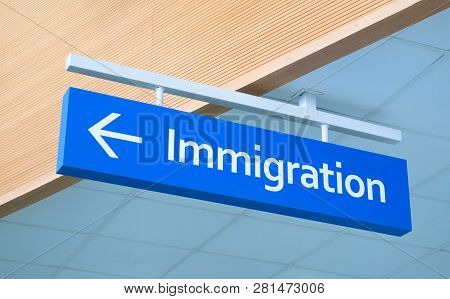 Immigration Sign In Airport. Airport Inscription Pointer. Immigration Concept Photo. Passport Contro