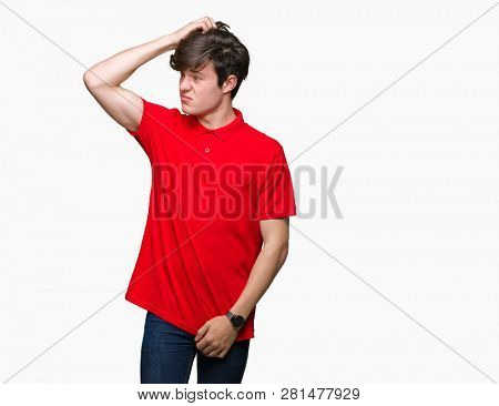 Young handsome man wearing red t-shirt over isolated background confuse and wonder about question. Uncertain with doubt, thinking with hand on head. Pensive concept.