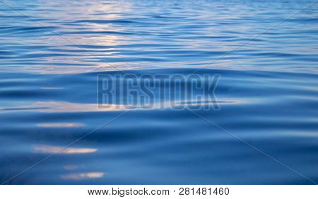 Blue Sea Water With Rippled Surface. Still Seawater Texture. Breezy Seaside Landscape. Fresh Clean W