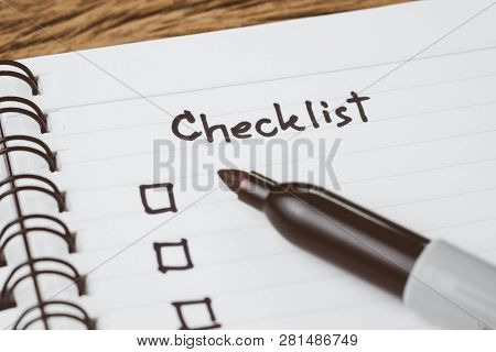 Selective Focus On Handwriting Headline The Word Checklist With Black Marker Pen And Check Box On Sm