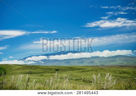 A View Of Mauna Kea From Waimea On The Big Island Of Hawaii. Green Pasture Land In The Foreground. B