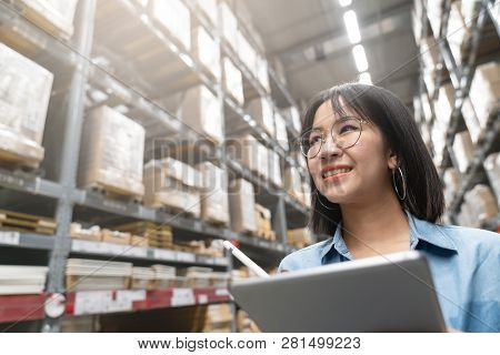 Close Up Of Young Attractive Asian Woman, Auditor Or Trainee Staff Work Stocktaking Inventory In War