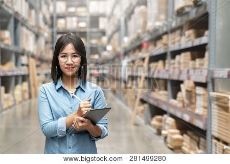 Young Attractive Asian Worker, Owner, Entrepreneur Woman Holding Smart Tablet Looking At Camera With