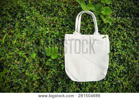 White Tote Canvas Fabric Eco Bag Cloth Shopping Sack On Green Leaf Nature Background / Zero Waste Us