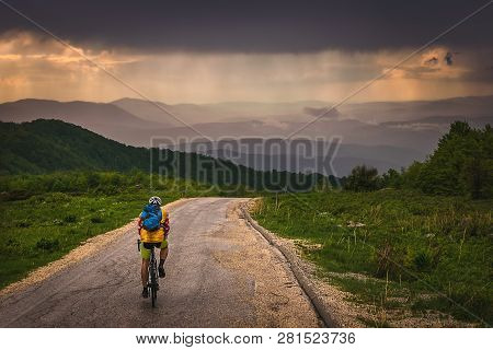 Cycling In Sunset. Lifestyle Concept. Man Cycling In Sunset In Mountain. Healthy Lifestyle. People L