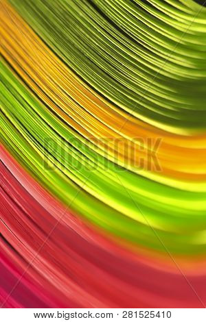 Abstract bright wavy lines on a black background. Saturated colorful background. poster