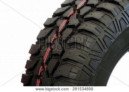 Tread Pattern Of Mud Terrain Tire On White Studio Isolated