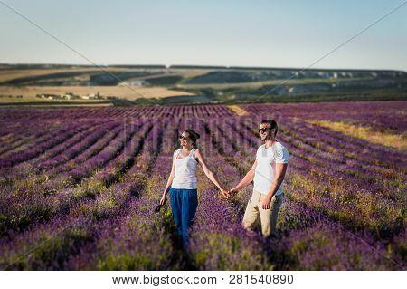 Couple In Love On Lavender Fields. Boy And Girl In The Flower Fields. Honeymoon Trip. Honeymoon. New