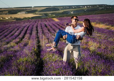 Couple In Love On Lavender Fields. Boy And Girl In The Flower Fields. Honeymoon Trip. Honeymoon. New