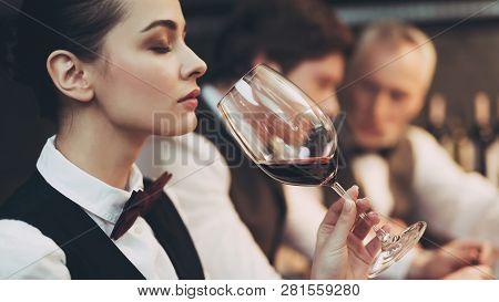 Experienced Sommelier Woman Explores Taste Of Wine In Restaurant. Wine Tasting. Checking Taste, Colo