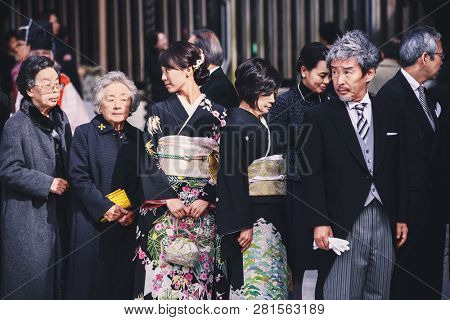 Tokyo, Japan - November 18, 2018: Guests during traditional Japanese wedding ceremony held in the Meiji Jingu (Meiji Shrine). Meiji Shrine is very popular place for Shinto wedding ceremony.