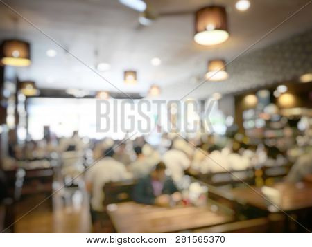 Abstract Blur And Defocused Of Crownd Of People Are Sitting For Eating Some Food With Their Family I