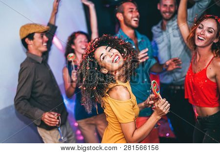 Happy Friends Doing Party At Night Club - Young Woman Having Fun With Her Group Of Mates Eating Cand