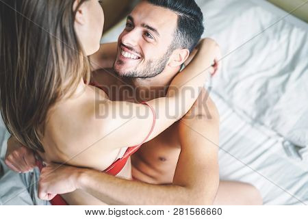 Passionate Couple Having Sex In The Bed - Young Lovers Intimate And Romantic Moments In The Bedroom