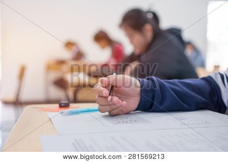 Exams Test Student In High School, University Student Holding Pencil For Testing Exam Writing Answer