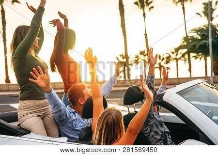 Happy Friends Having Fun In Convertible Car In Vacation - Young People Enjoying Time Traveling And D
