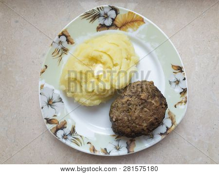 Top View On A Triangle Shape Plate With Potato Mash And Homemade Cutlet