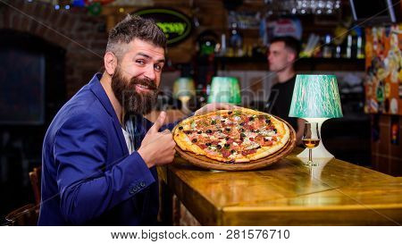 Hipster Client Sit At Bar Counter. Man Received Delicious Pizza. Enjoy Your Meal. Cheat Meal Concept