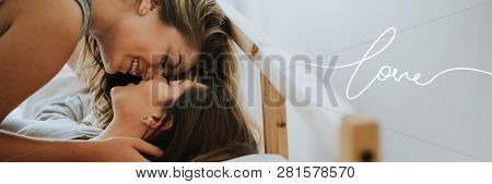 Lesbian couple kissing in the morning