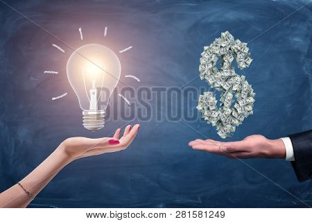 A Female And A Male Hands Holding A Large Bright Light Bulb And A Dollar Sign Made Of Many Money Bil