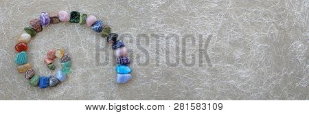 Crystal Fibonacci Spiral Background Banner -  Carefully Arranged Crystal Healing Gemstones In Spiral