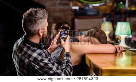 Man Drunk Fall Asleep And Guy With Smartphone. Hipster Taking Photo Drunk Friend. Drunk Friends In B